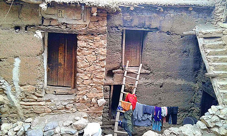 A typical mud and stone built house in a village in the High Atlas