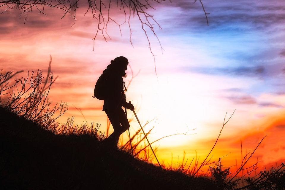Backpacker hiker at sunset