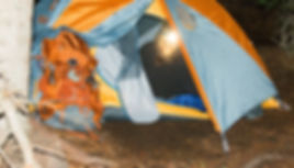 Bigfoot sasquatch in backpack tent