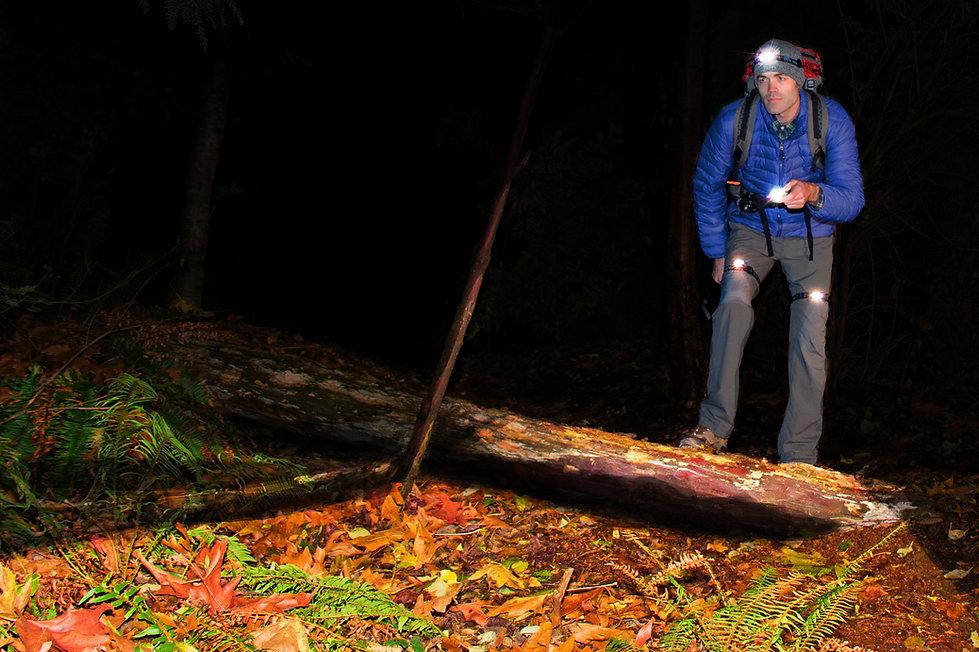 cyrad headlamp, leglight, and flashlight system at night in Fall