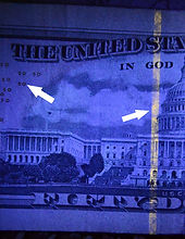US currency and IDs have hidden marks exposed by UV