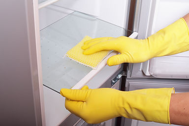Canva - Hands cleaning refrigerator..jpg