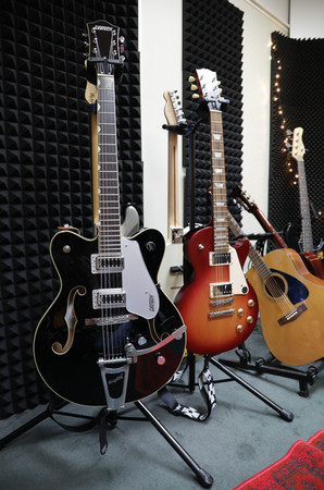 Gretsch 5422T hollow body and the Gibson Les Paul electric guitars