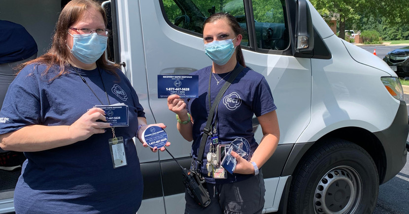 MCT employees holding up out stickers