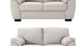 Two leather two seater sofas sold as a set retail normally at £399 each