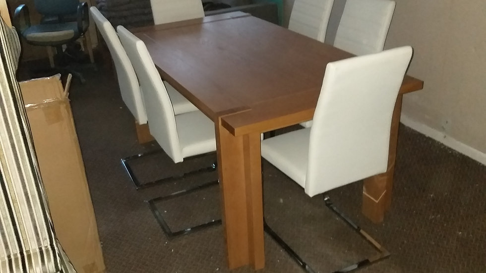 Solid oak extending dinning table with six chairs in black or white leather