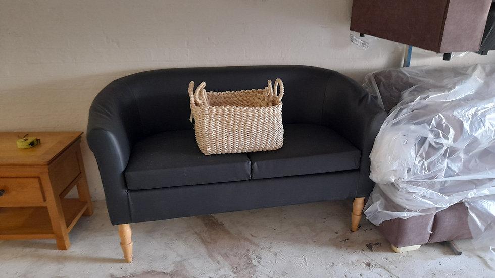 Jet-black leatherette tub sofa