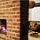 Brick slips used for a central fireplace to replicate exposed brick appearence
