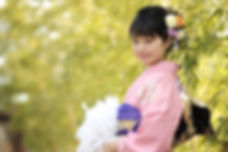 girl smiling in pink kimono with purple obi