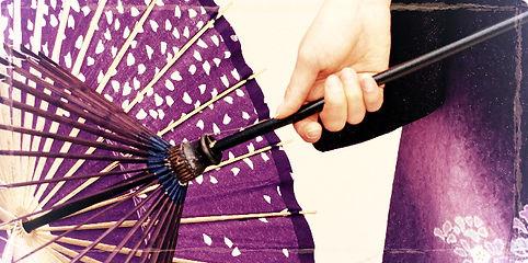 lady in purple kimono holding Japanese style umbrella