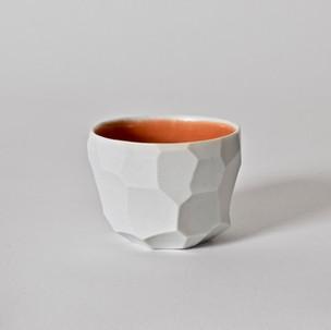 "Faceted cup 2.5"" x  2"" unglazed porcelain, orange glaze 2013"