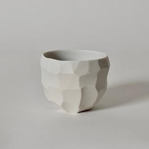 """Faceted cup #2 2"""" x  3"""" unglazed porcelain 2013"""