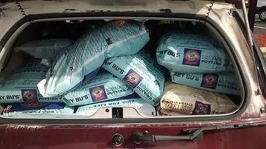 Malibu Compost bags in car
