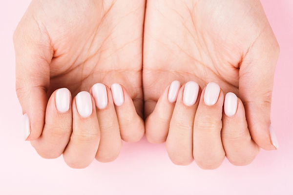 womans-hands-with-pastel-manicure-on-pin