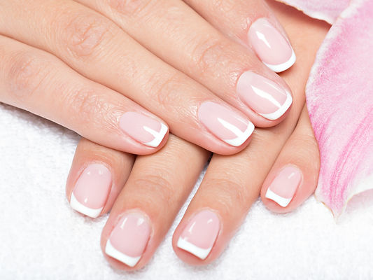 beautiful-womans-nails-with-french-manic