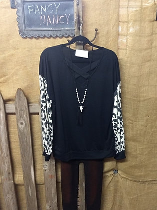 Black fleece top with white leopard sleeves