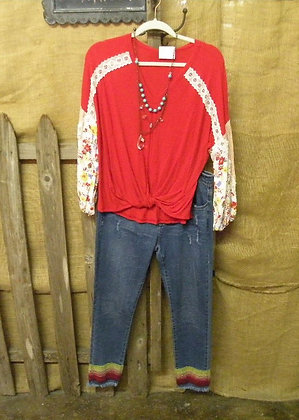 Red top with full floral sleeves