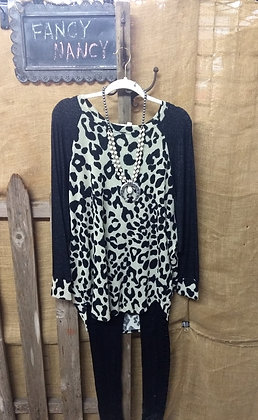 White leopard fleece top with trimmed black sleeves