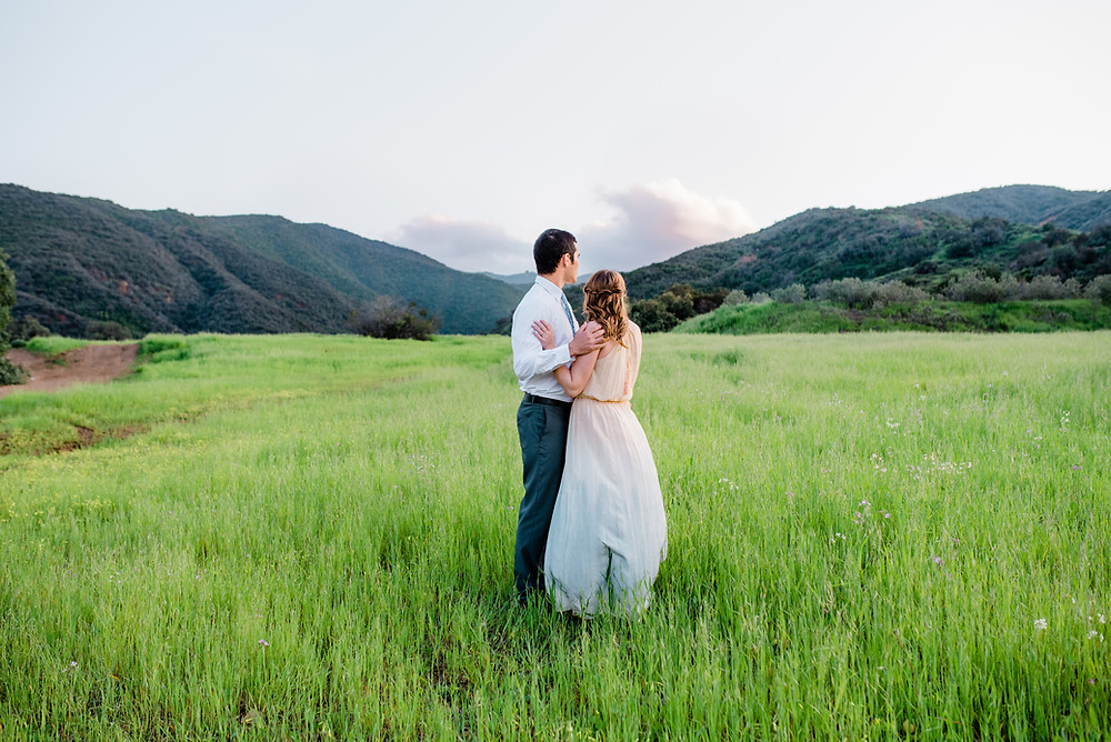 Corona open field engagement session mountain backdrop