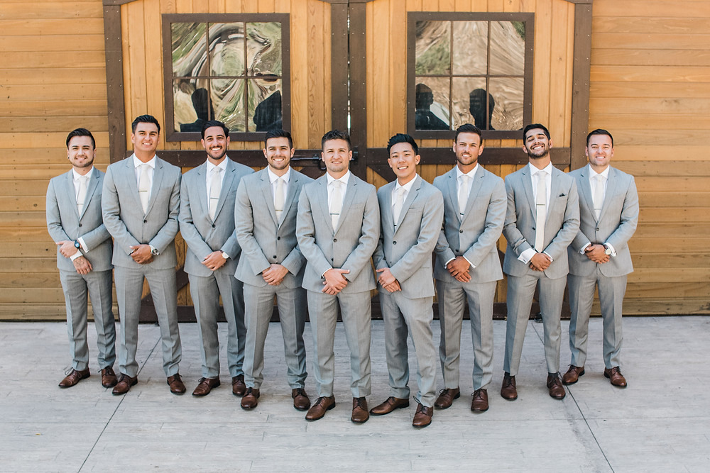 groomsmen in grey suites