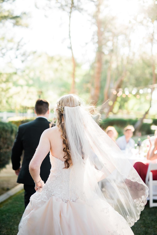 bride walking away at reception