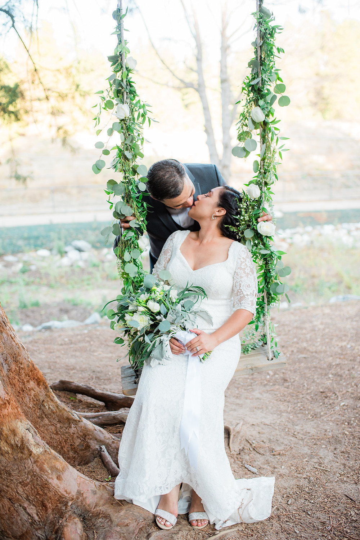 wedding swing portrait covered in garland