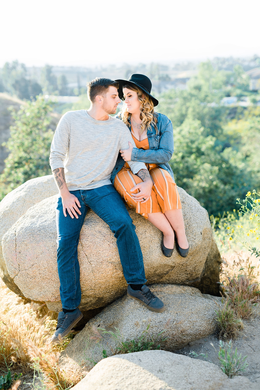 jean jacket couple session, women's orange jumper, engagement session, riverside photoshoot