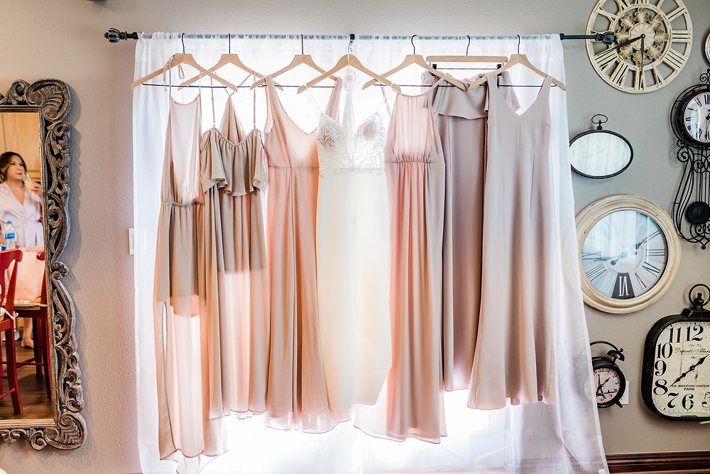 bridal suite with wedding dress hanging