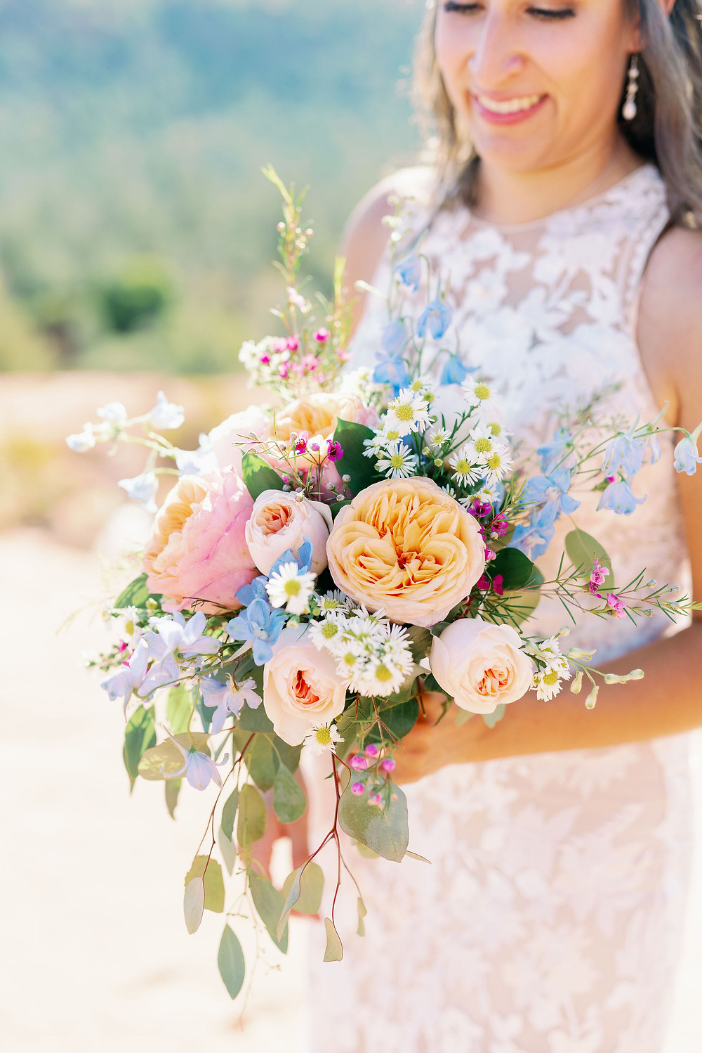 pink and blue wedding bouquet wildflower style