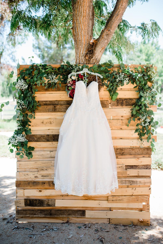 sequined wedding dress hanging from door