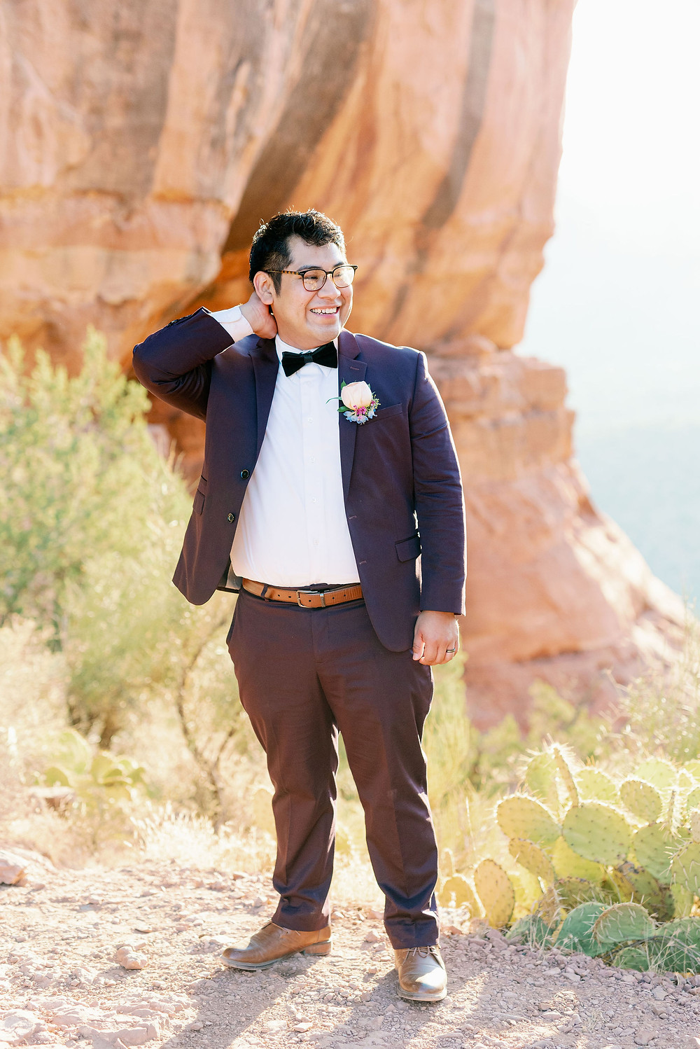 groom in wedding tux at cathedral rock Sedona