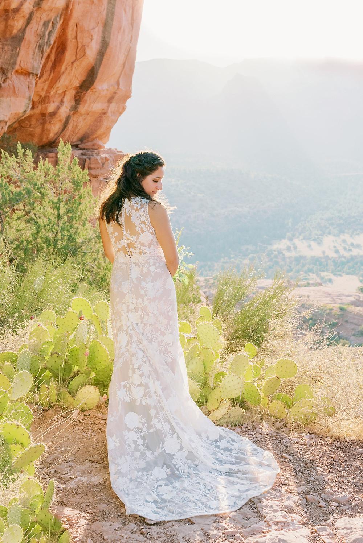 bride is wedding dress at cathedral rock Sedona