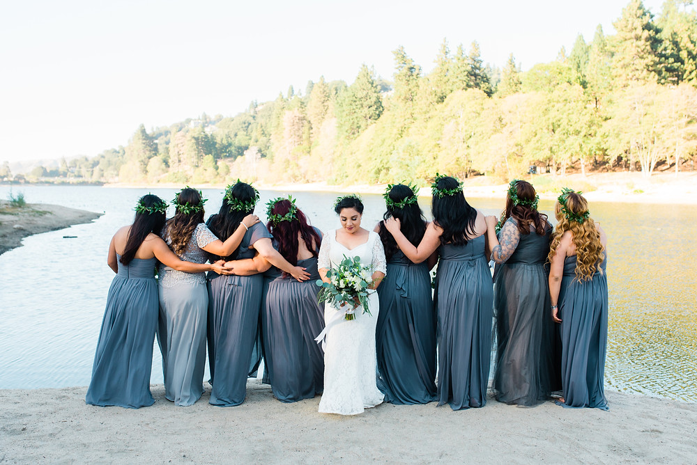 bohemian bridal party portrait  in front of lake Gregory