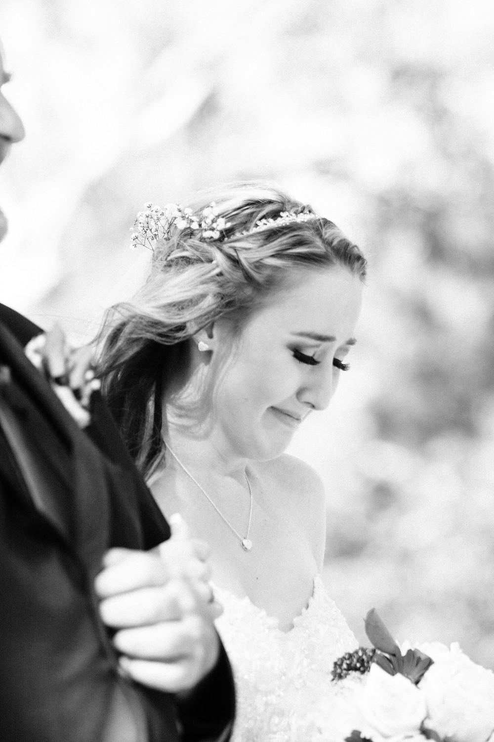 bride crying walking down the isle