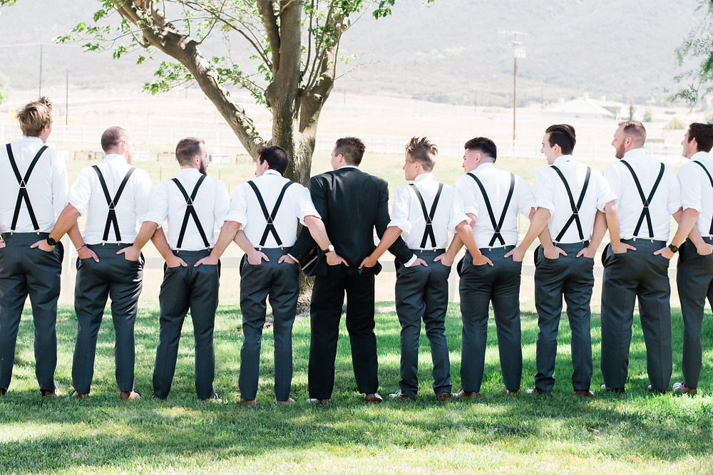 groomsmen holding butts bridal party photo