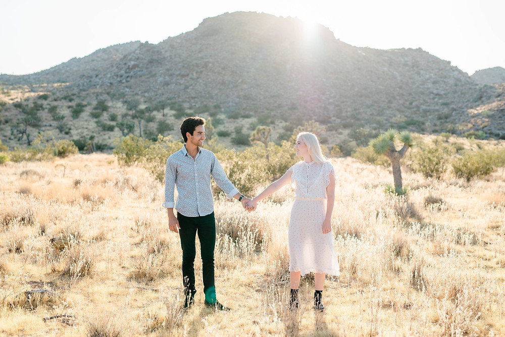 hipster in joshua tree holding hands