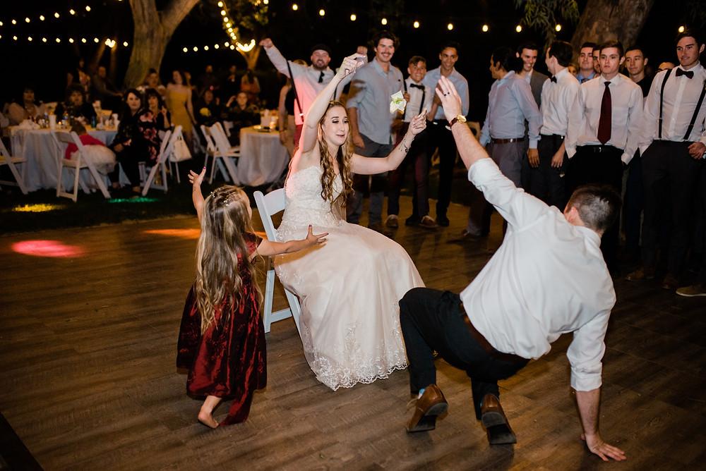 groom taking off garter