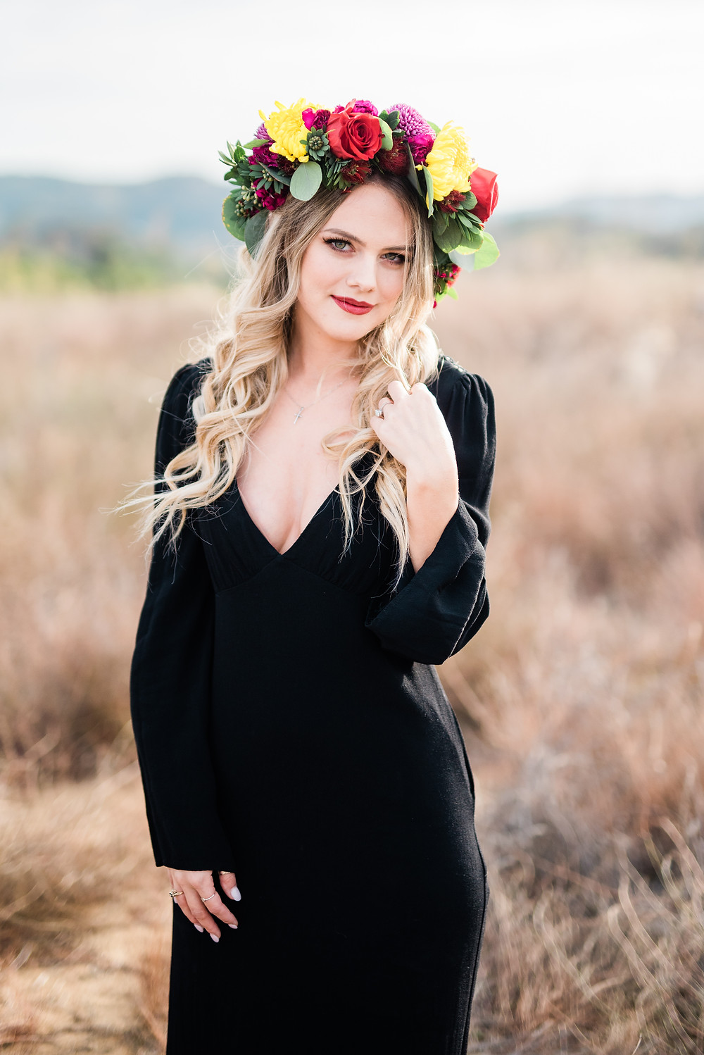 bride with black wedding dress and flower crown