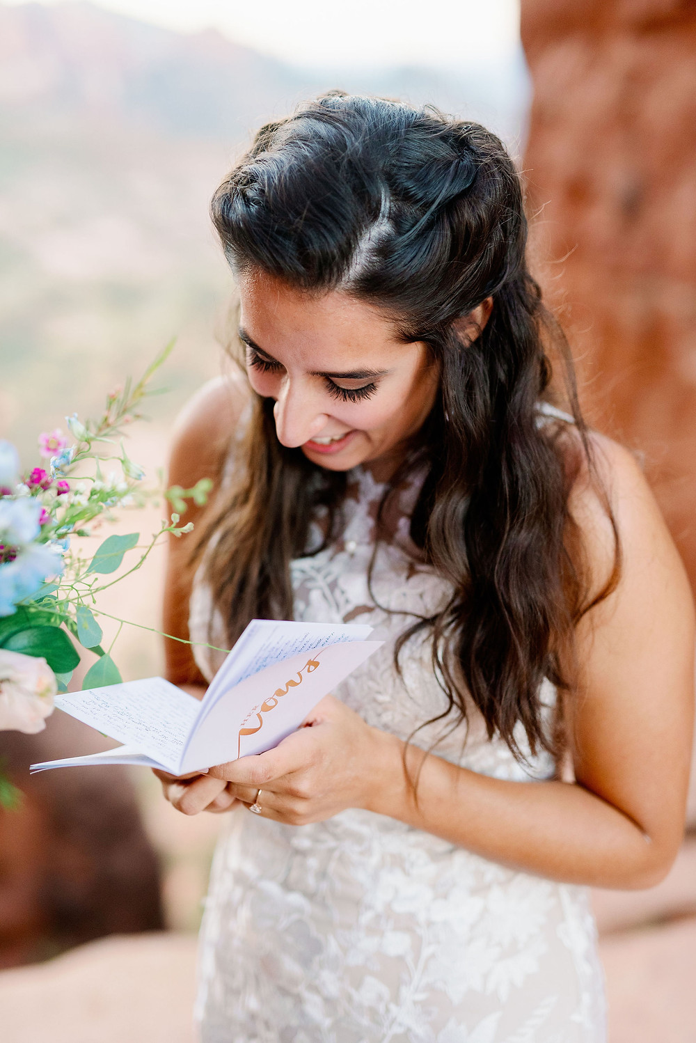 Sedona elopement on cathedral rock at sunrise bride reading vows