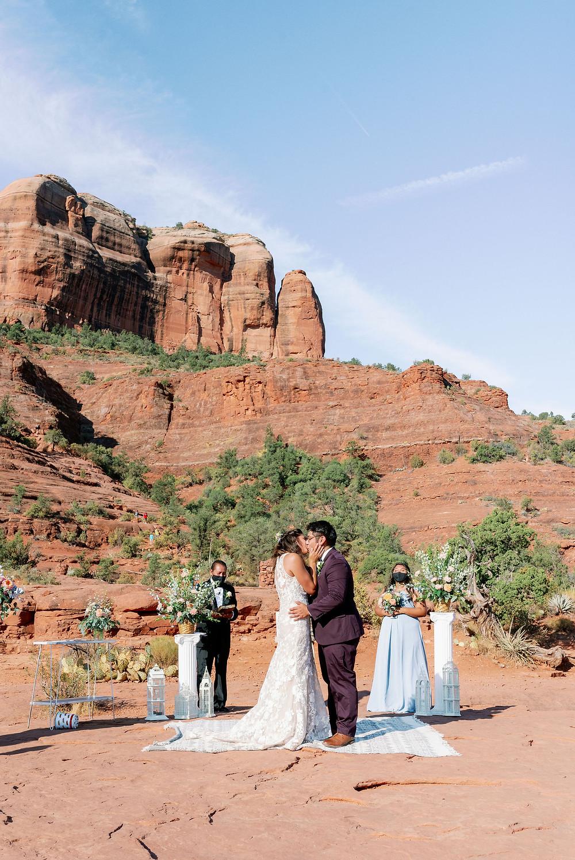Sedona wedding ceremony first kiss at sunrise