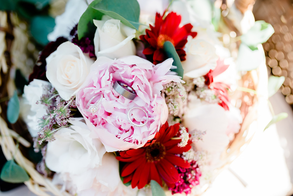 wedding rings in pink floral bouquet