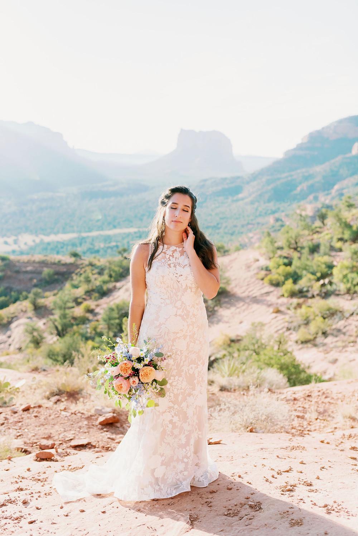 adventure bride in wedding dress at cathedral rock Sedona