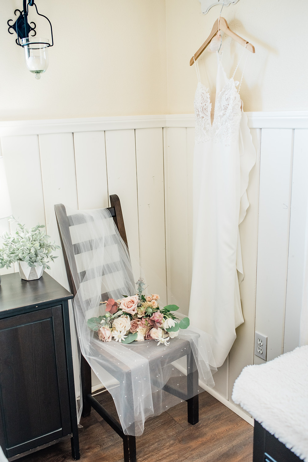 wedding dress hanging in bridal suite at serendipity gardens