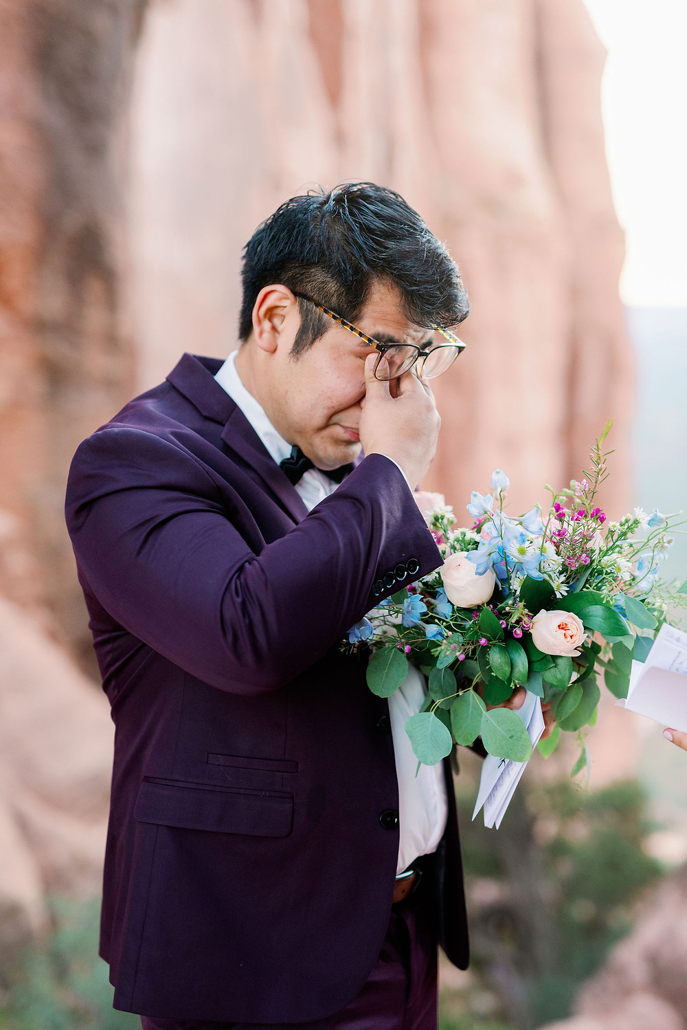 emotional groom crying reading vows
