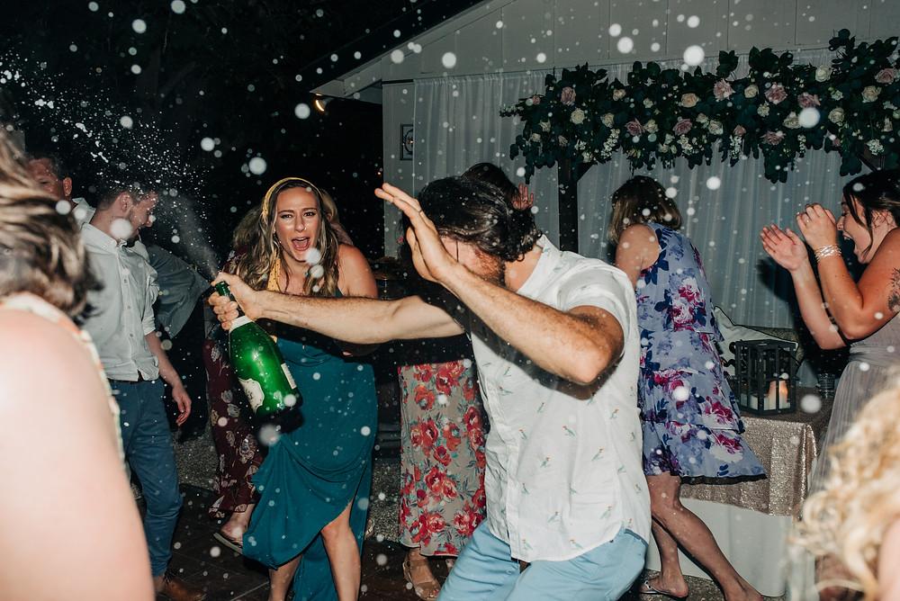 popping champagne wedding reception