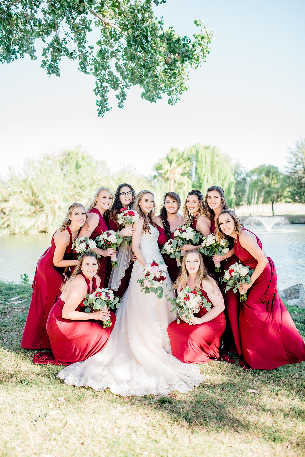 Bridal party photo with red dresses