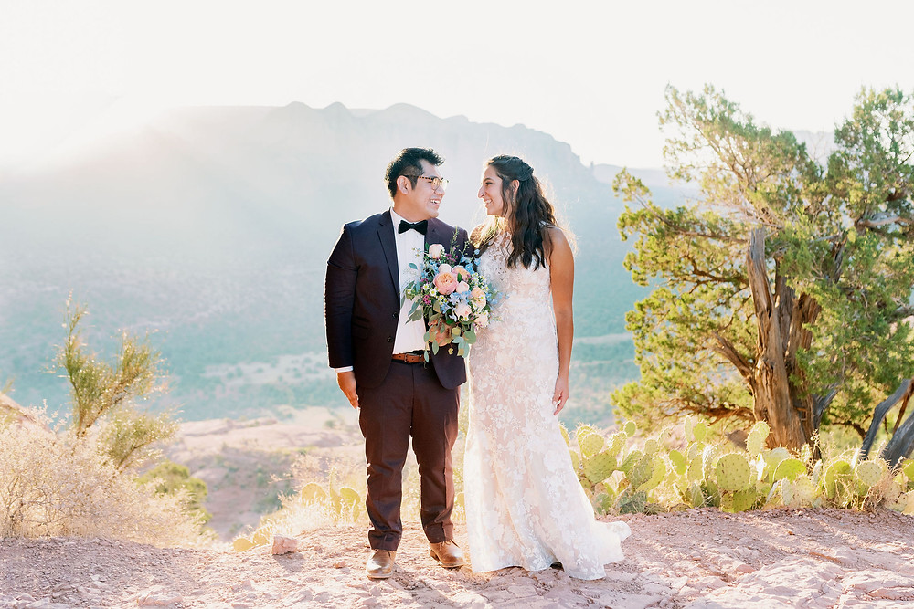 bride and groom kiss at sunrise for sedona elopement