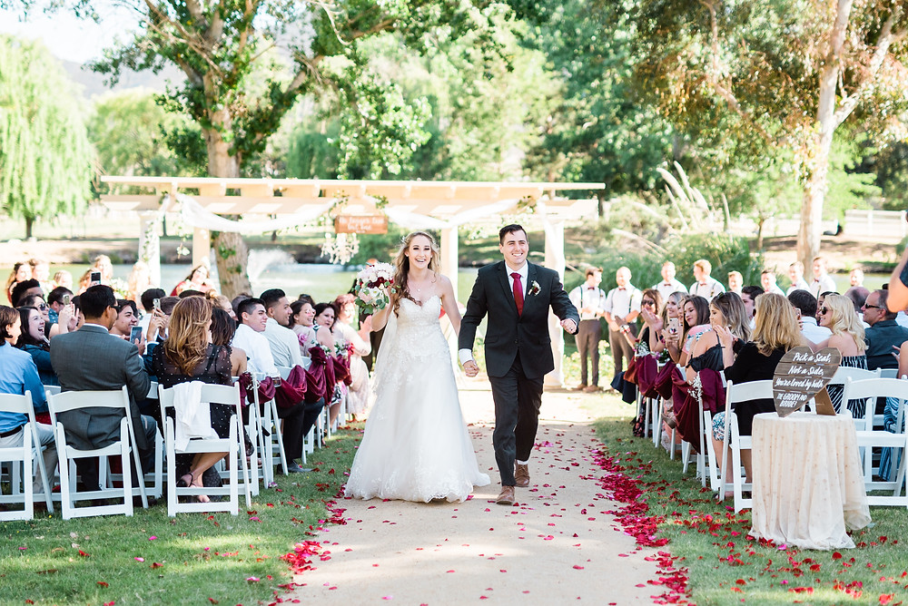 bride and groom walking down the isle