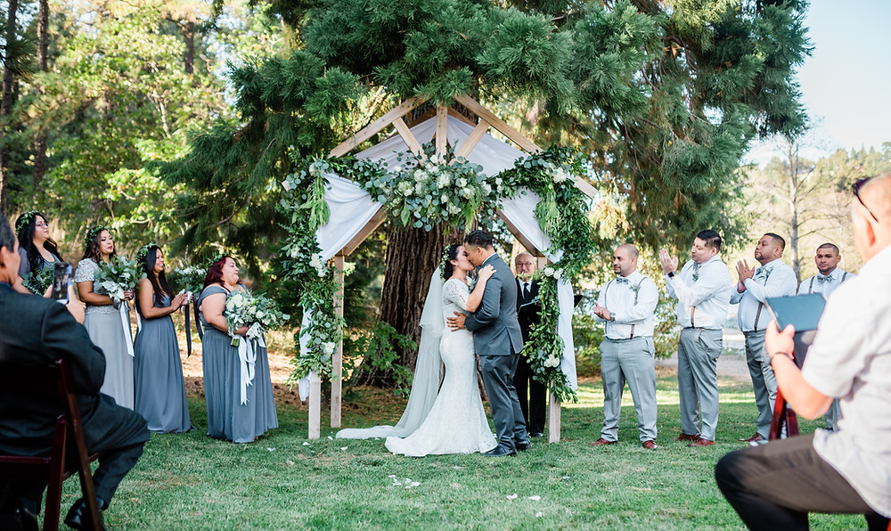 romantic forest ceremony with rustic archway