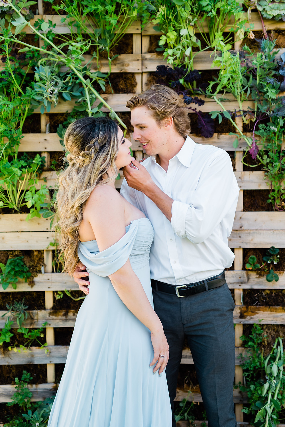 Temecula olive oil company engagement photos man holding girls chin pose